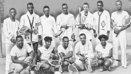 Tennis players hold trophies while on the segregated tennis courts at Druid Hill Park, Baltimore, Maryland, 1946