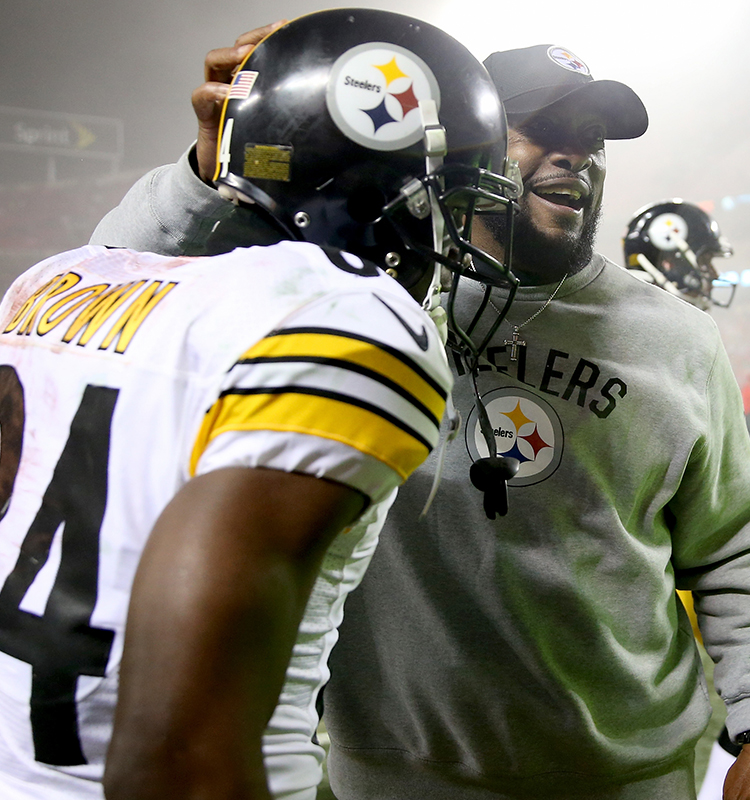 1233f5a9f Head coach Mike Tomlin of the Pittsburgh Steelers congratulates wide  receiver Antonio Brown after the Steelers beat the Kansas City Chiefs.