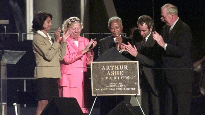 eanne Moutoussamy-Ashe, left, widow of the late Arthur Ashe applauds the unveiling of the plaque dedicating the new stadium in his name at the U.S. Open Tennis Center in New York on Monday night, August 25, 1997.