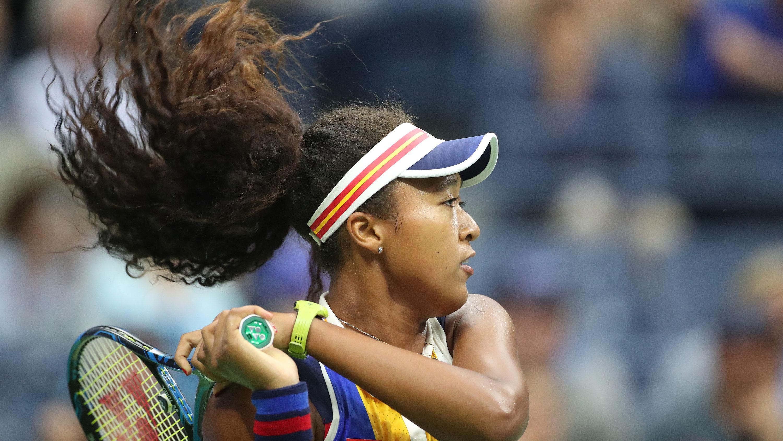Naomi Osaka playing tennis