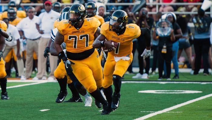 Grambling quarterback Devante Kincade avoids the Jackson State defense.
