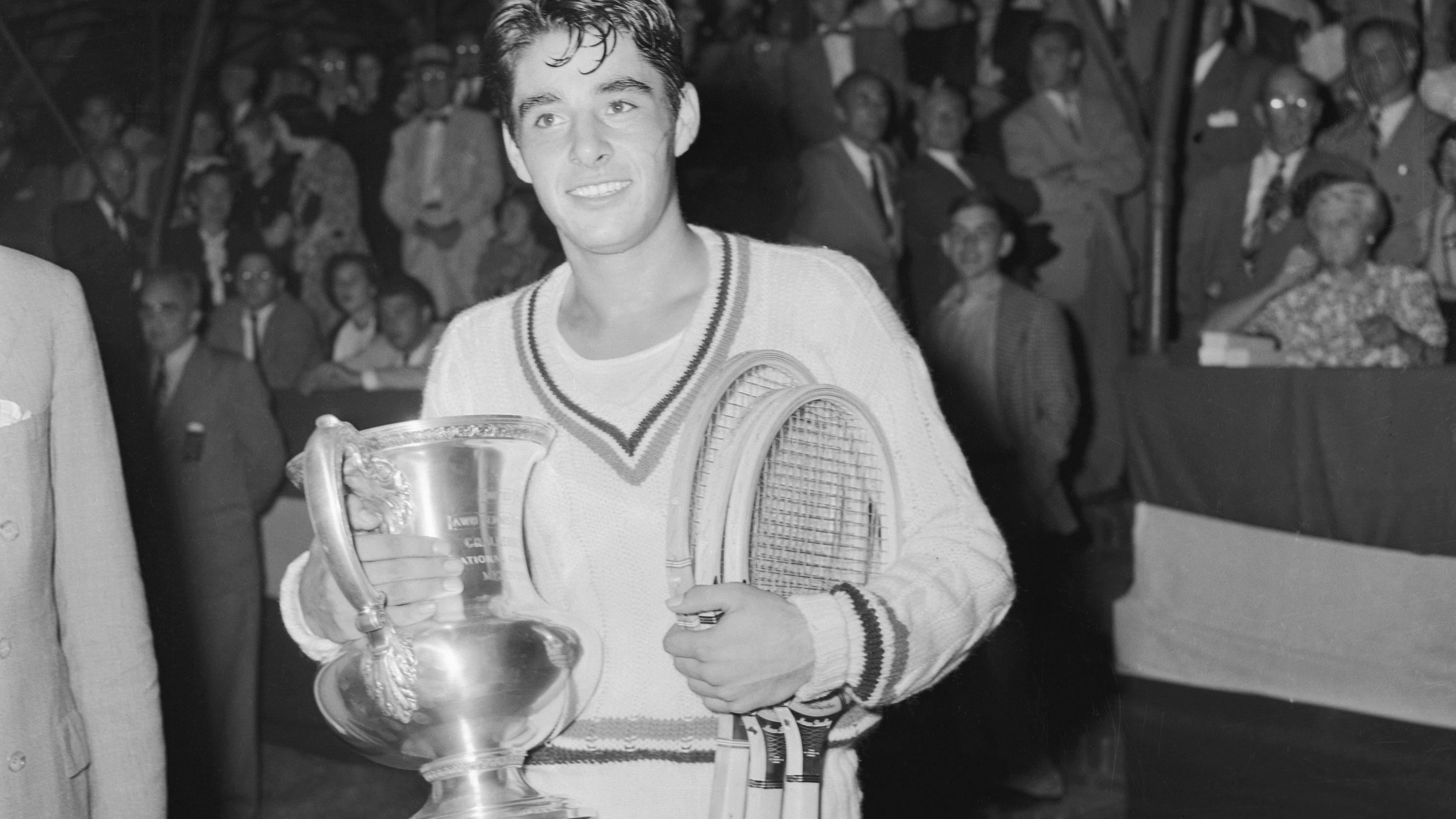 Richard Gonzales Holding Tennis Trophy