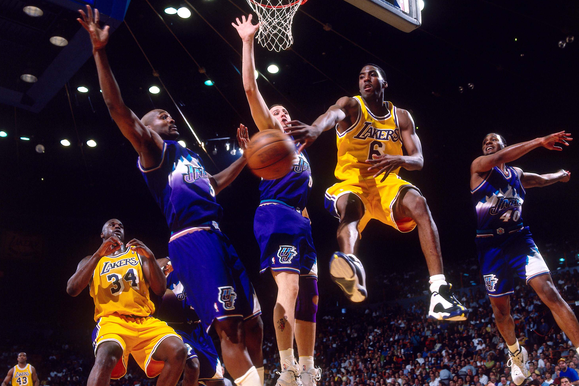59797c0a8cdce7 Eddie Jones (second from right) of the Los Angeles Lakers passes against  the Utah Jazz in Game 3 of the Western Conference finals played on May 22