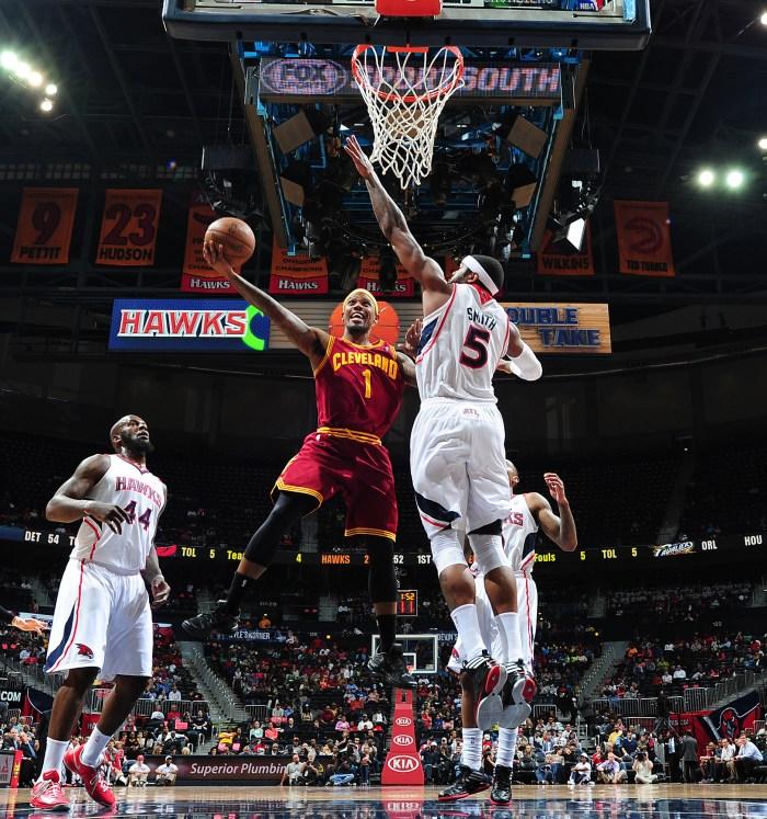 4f3da47b79d Daniel Gibson  1 of the Cleveland Cavaliers shoots against Josh Smith  5 of  the Atlanta Hawks on April 1