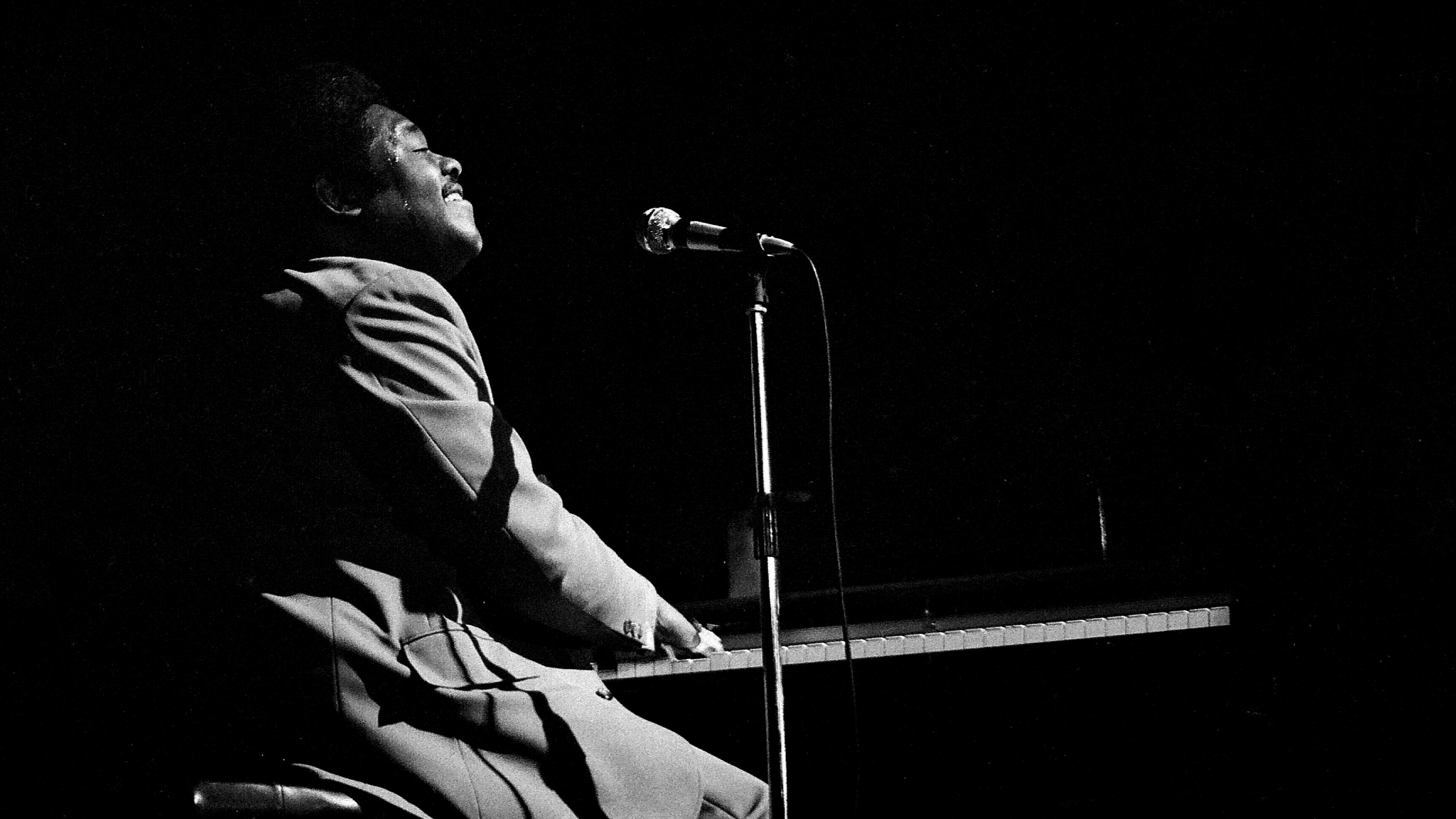 Fats Domino, American pianist, singer and conducto