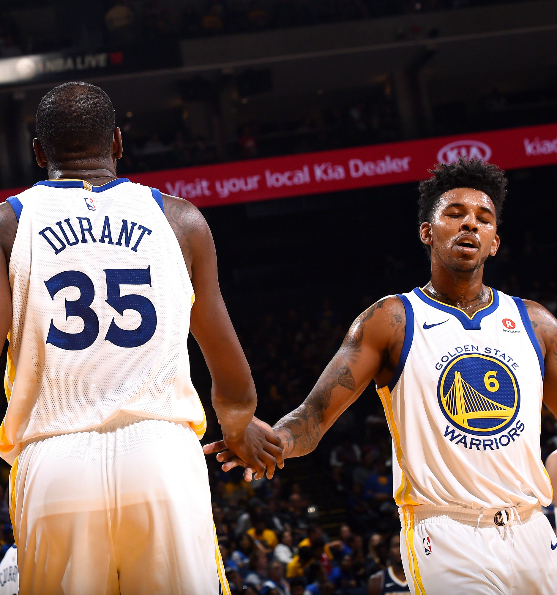 5a0bda5e3 Kevin Durant (left) and Nick Young of the Golden State Warriors high-five  each other during their preseason game against the Denver Nuggets on Sept.