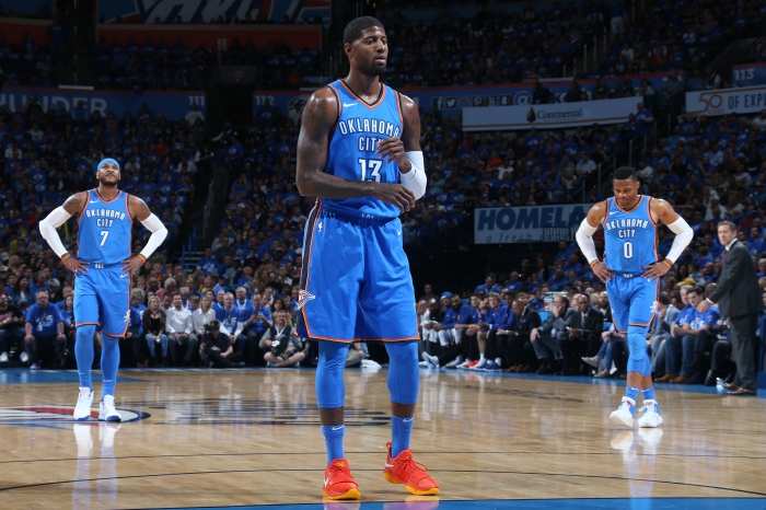 Paul George  13 shoots a foul shot while Carmelo Anthony  7 and Russell  Westbrook  0 of the Oklahoma City Thunder look during the game against the  New York ... 7ba544eb6