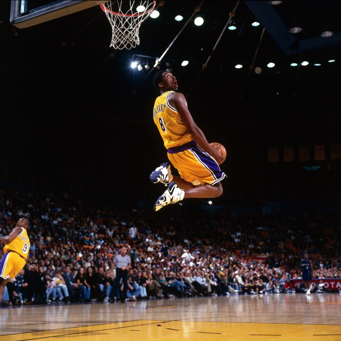 ba76e316721 Kobe Bryant of the Los Angeles Lakers goes up for a reverse slam dunk  against the Minnesota Timberwolves during an NBA game at the Staples Center  circa 1998 ...