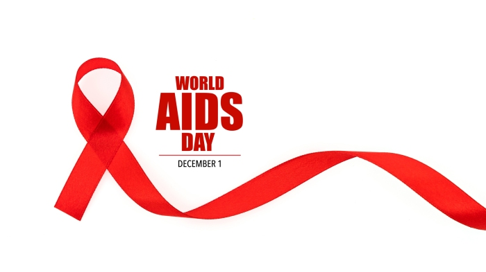 Red ribbon for World AIDS Day on white background