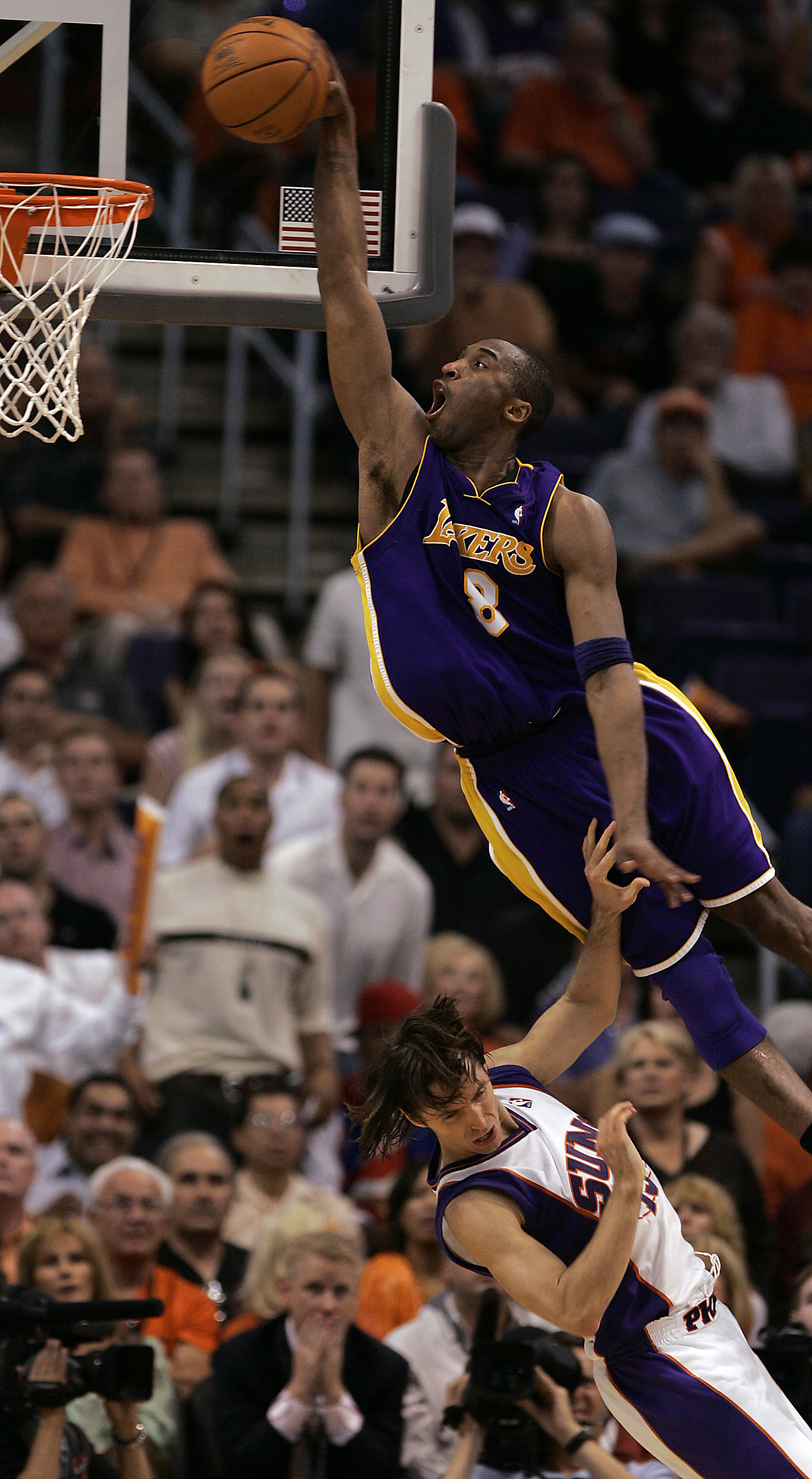 984cbb841f9 Kobe Bryant goes for the dunk over the Phoenix Suns' Steve Nash in the  fourth quarter with emphasis in game two of the NBA Western Conference  quarterfinals ...