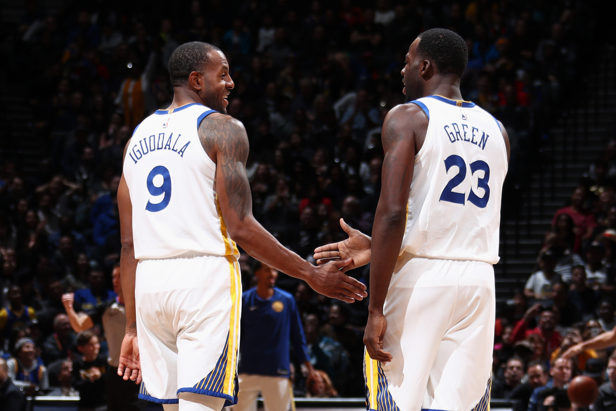 ad8dc220a Draymond Green and Andre Iguodala high five during game.