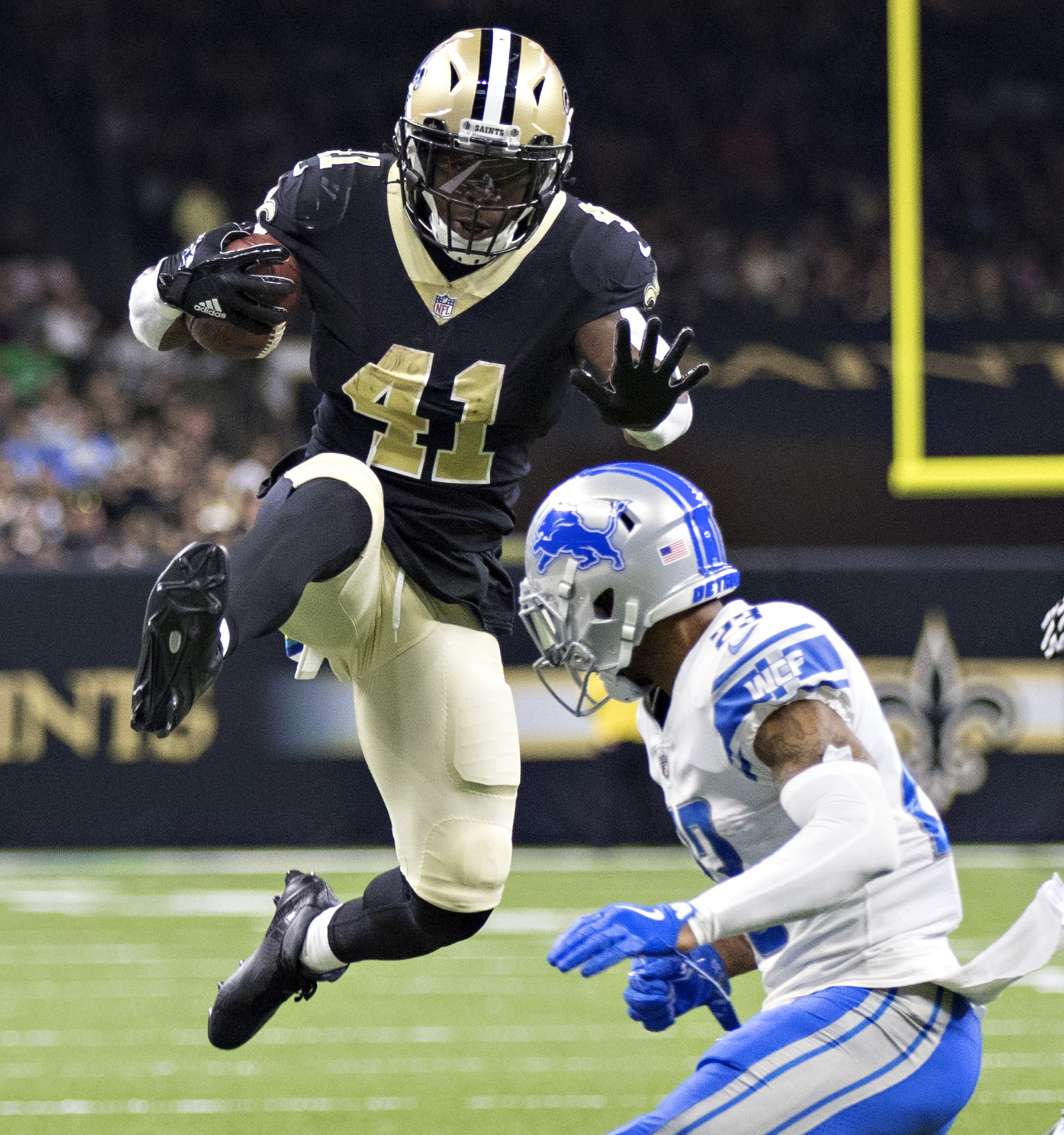 Saints running back Alvin Kamara jumps over Darius Slay of the Detroit  Lions. aa9a96081