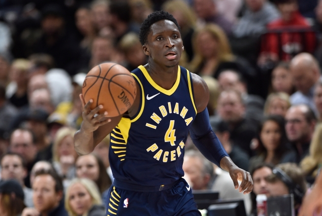 Victor Oladipo of the Indiana Pacers brings the ball upcourt during a game  against the Utah Jazz at Vivint Smart Home Arena on Jan. 15 in Salt Lake  City. 1b58027bb