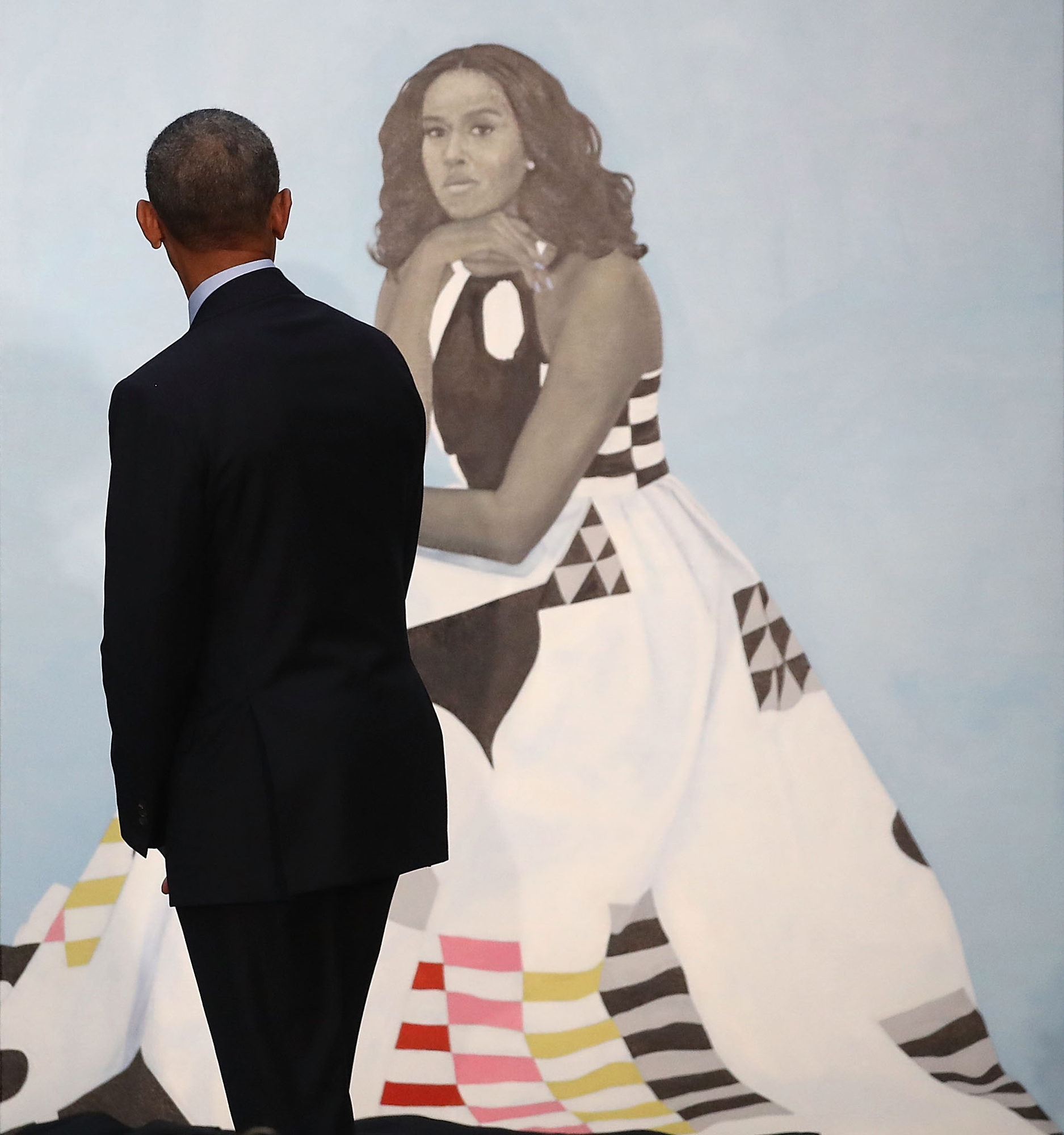 20324e1828a Former U.S. president Barack Obama looks at former first lady Michelle  Obama s newly unveiled portrait during a ceremony at the Smithsonian s  National ...