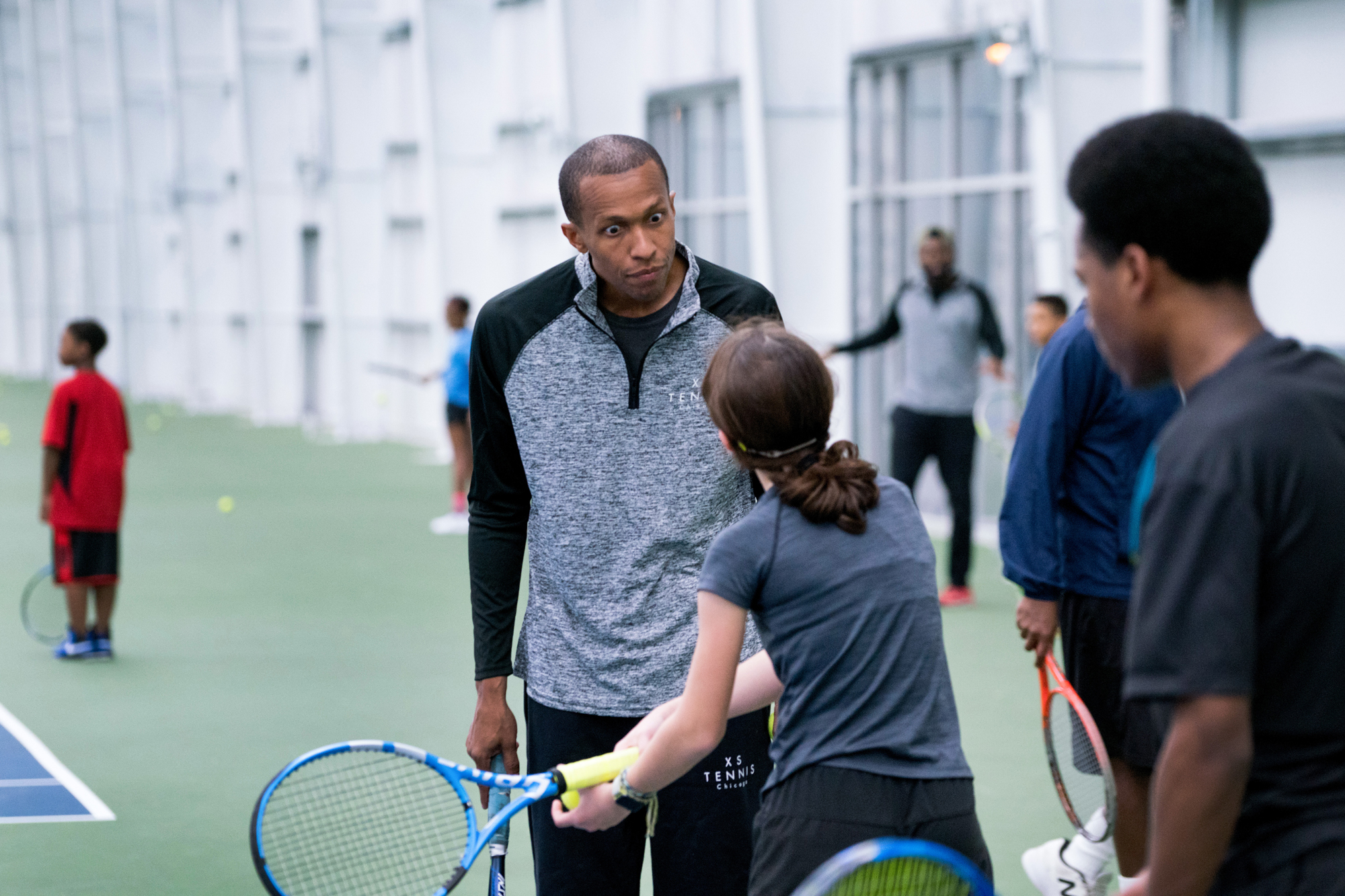e648090b63ef Tennis coach Kamau Murray confronts a young player on the indoor courts at  the non-profit XS Tennis Village in Chicago.