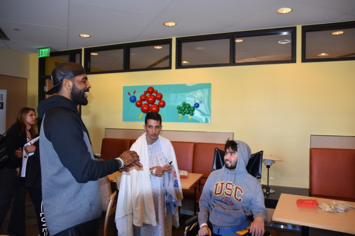 a18d341b28 Boston Celtics point guard Kyrie Irving visits with patients Shadi Hawatamh  and Ariel Aramnia at the Children's Hospital of Los Angeles on Feb.