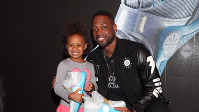 b5ce736fd1c24b Dwyane Wade poses with the raffle winner of the new limited-edition All-Star  Way of Wade 6 shoe
