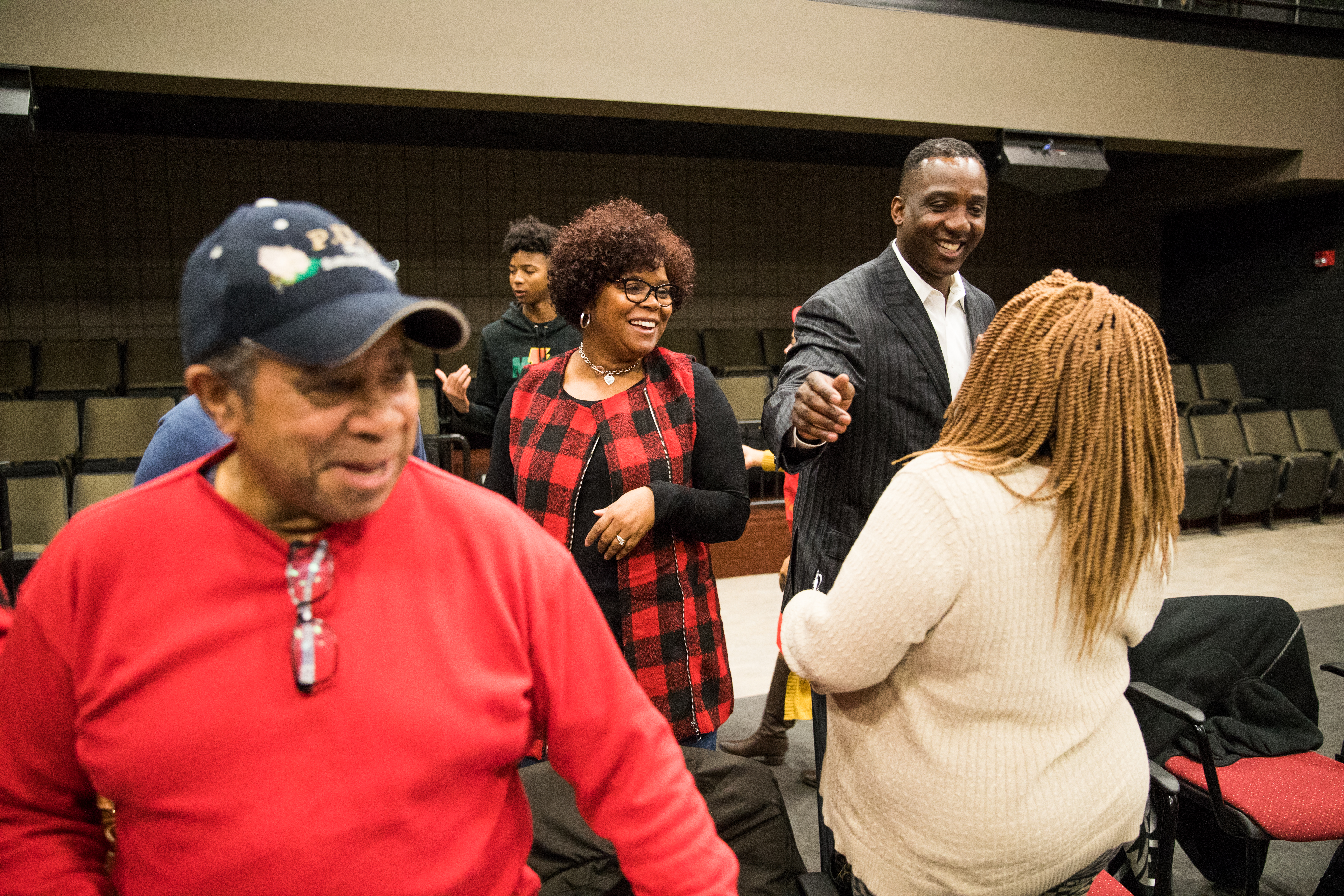 e3c02f54f Mike Warfield gets congratulations at the school board meeting in which he  was appointed the school s new head football coach.