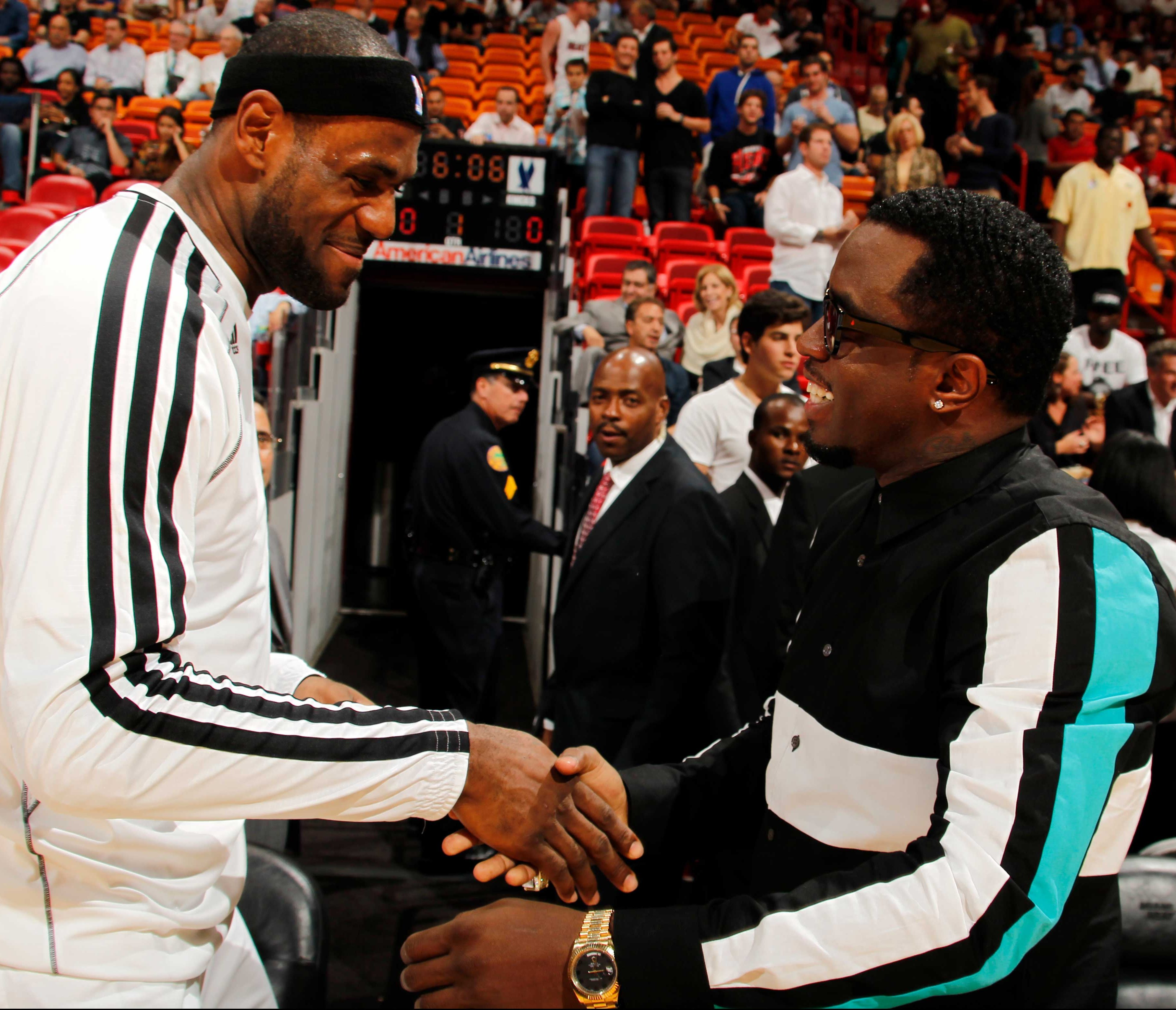 LeBron James  6 of the Miami Heat speaks with Recording Artist Sean P.  Diddy Combs prior to the New York Knicks  cbc58563f