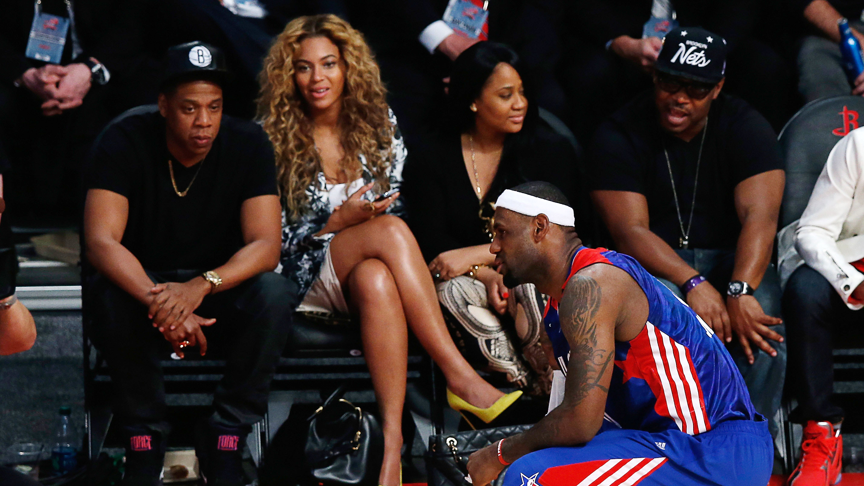 aee2ce5046a Rapper Jay-Z and Beyonce look over at LeBron James  6 of the Miami Heat and  the Eastern Conference during the 2013 NBA All-Star game at the Toyota  Center on ...