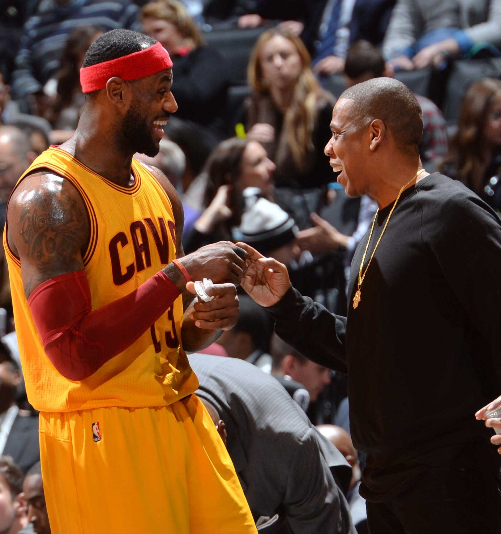 aef17a4b39b2 LeBron James  23 of the Cleveland Cavaliers shakes hands with Jay-Z during  the game against the Brooklyn Nets on December 8