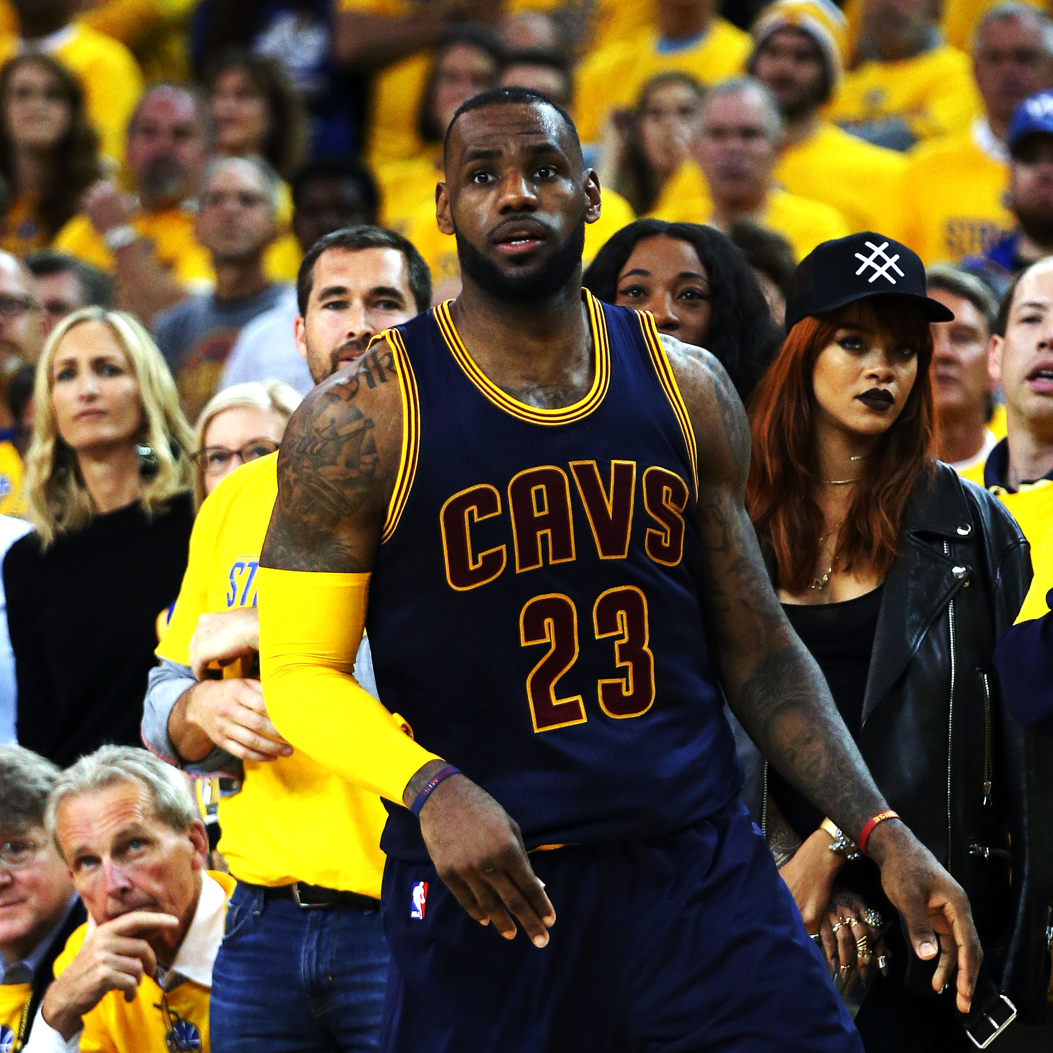 cae590c3d Rihanna watches as LeBron James  23 of the Cleveland Cavaliers plays  against the Golden State Warriors during Game One of the 2015 NBA Finals at  ORACLE ...