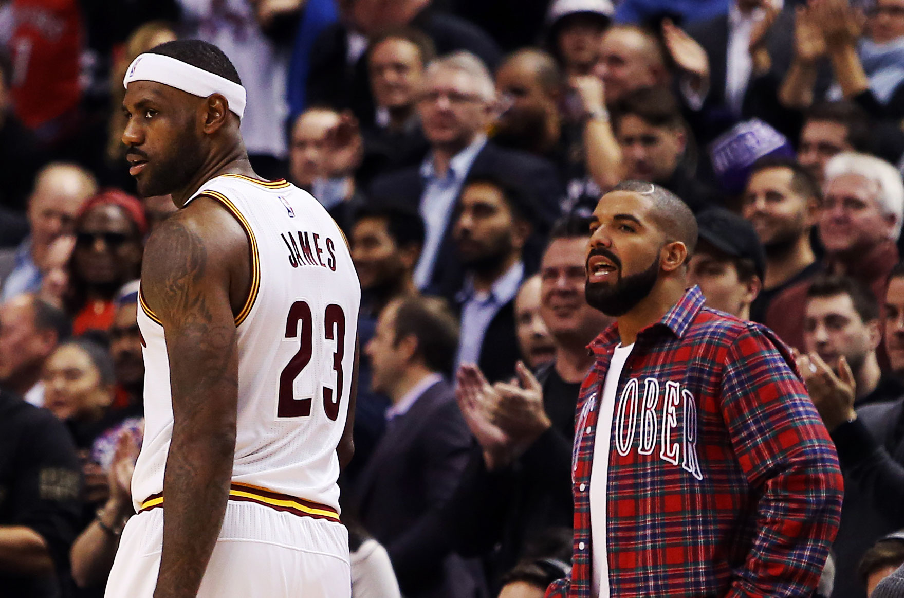 Drake talks to LeBron James  23 of the Cleveland Cavaliers during an NBA  game between the Cleveland Cavaliers and the Toronto Raptors at the Air  Canada ... 30f1a0278