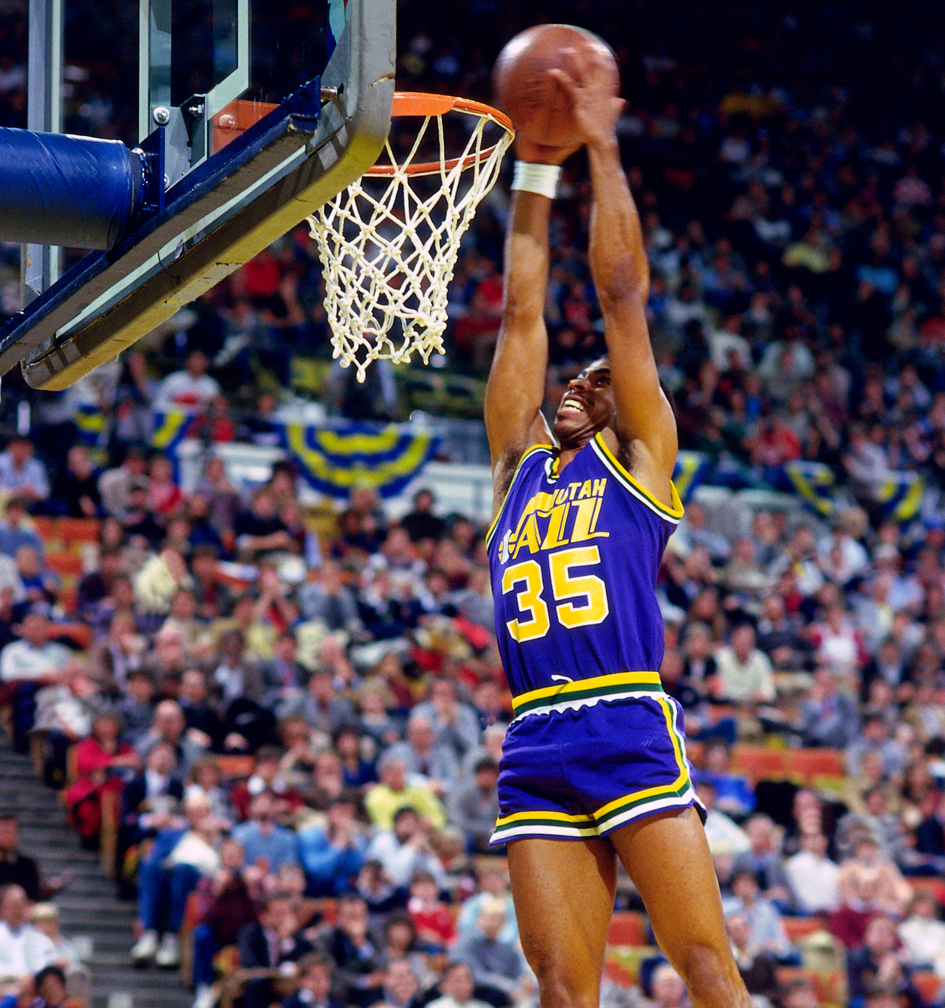 Darrell Griffith of the Utah Jazz dunks the ball during the Slam Dunk  contest as part of the 1985 NBA All-Star Game at the Hoosier Dome in  Indianapolis on ... 4d8b8ff47
