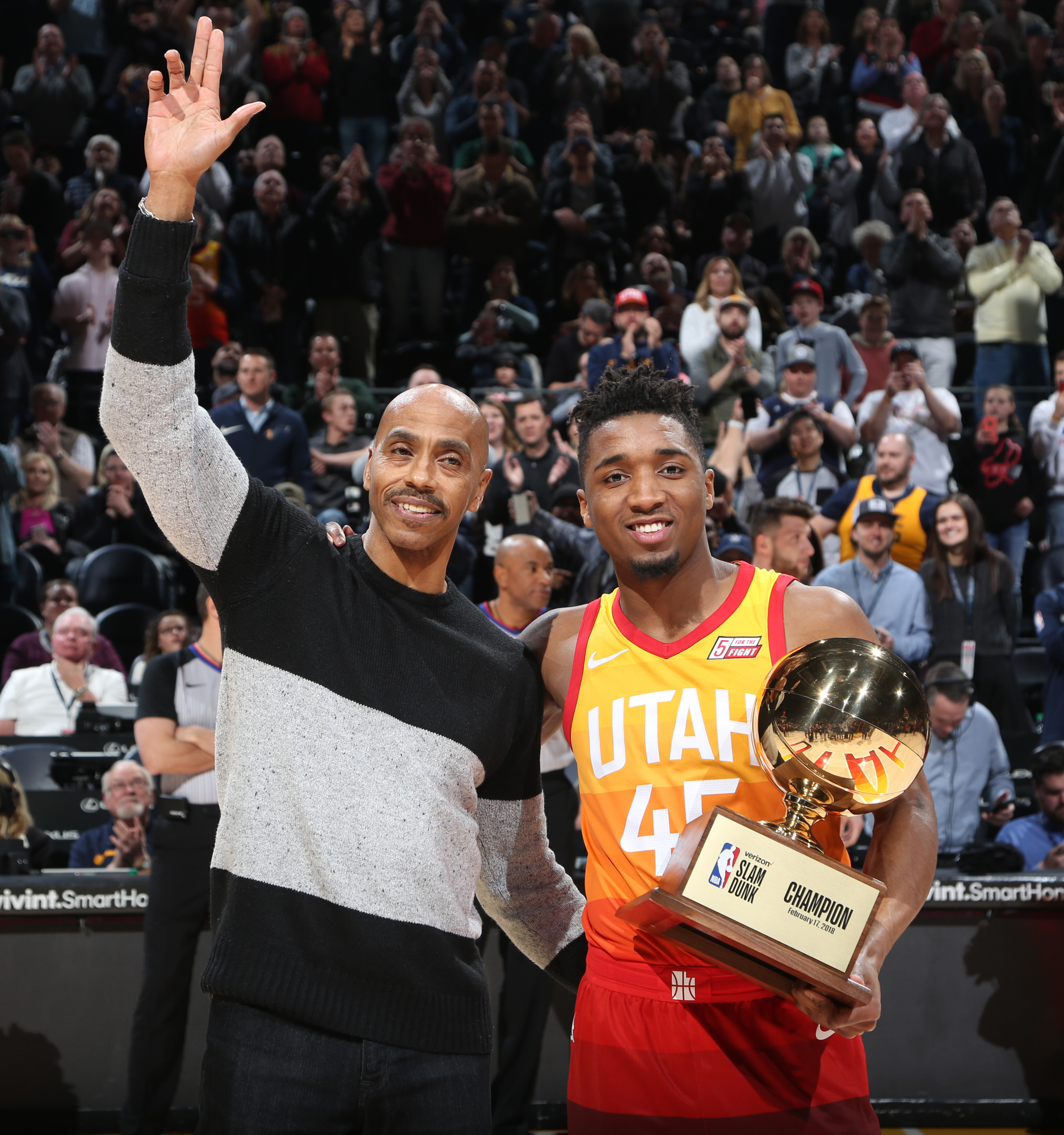Darrell Griffith (left) and Utah Jazz rookie Donovan Mitchell share  Mitchell s dunk contest trophy with the crowd at vivint.SmartHome Arena on  Feb. a4666aab1