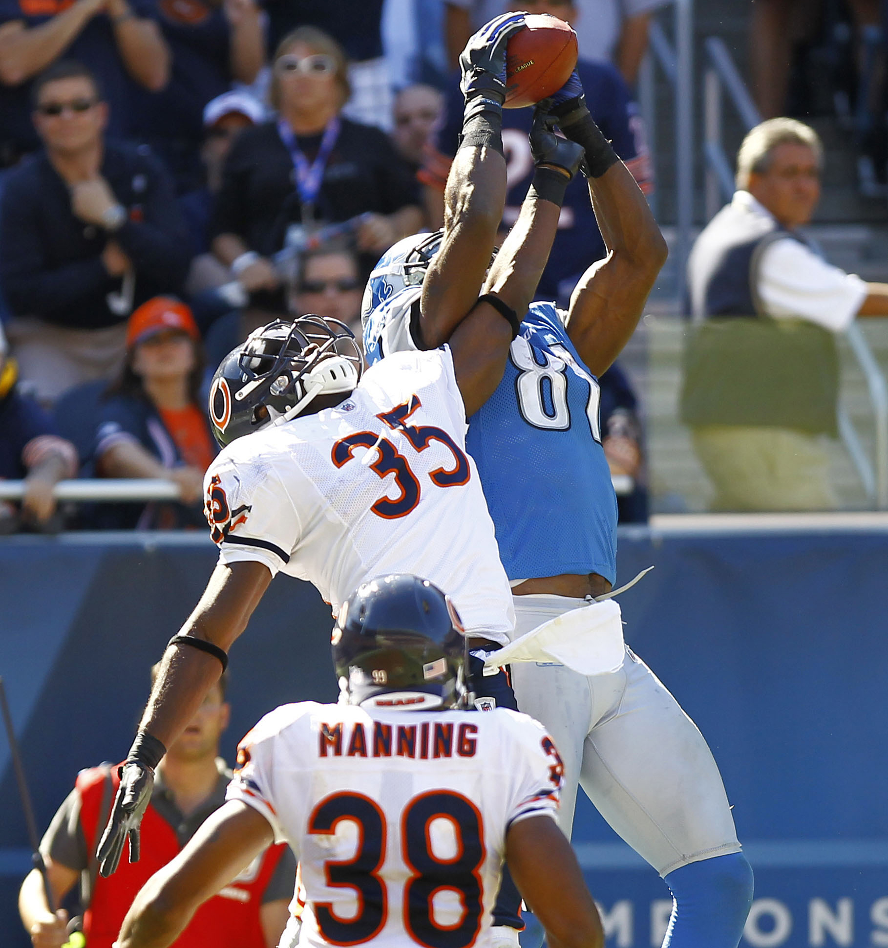 93778e1bb Detroit Lions wide receiver Calvin Johnson (81) is unable to maintain  possession of a ball in the end zone while defended by Chicago Bears  cornerback Zack ...