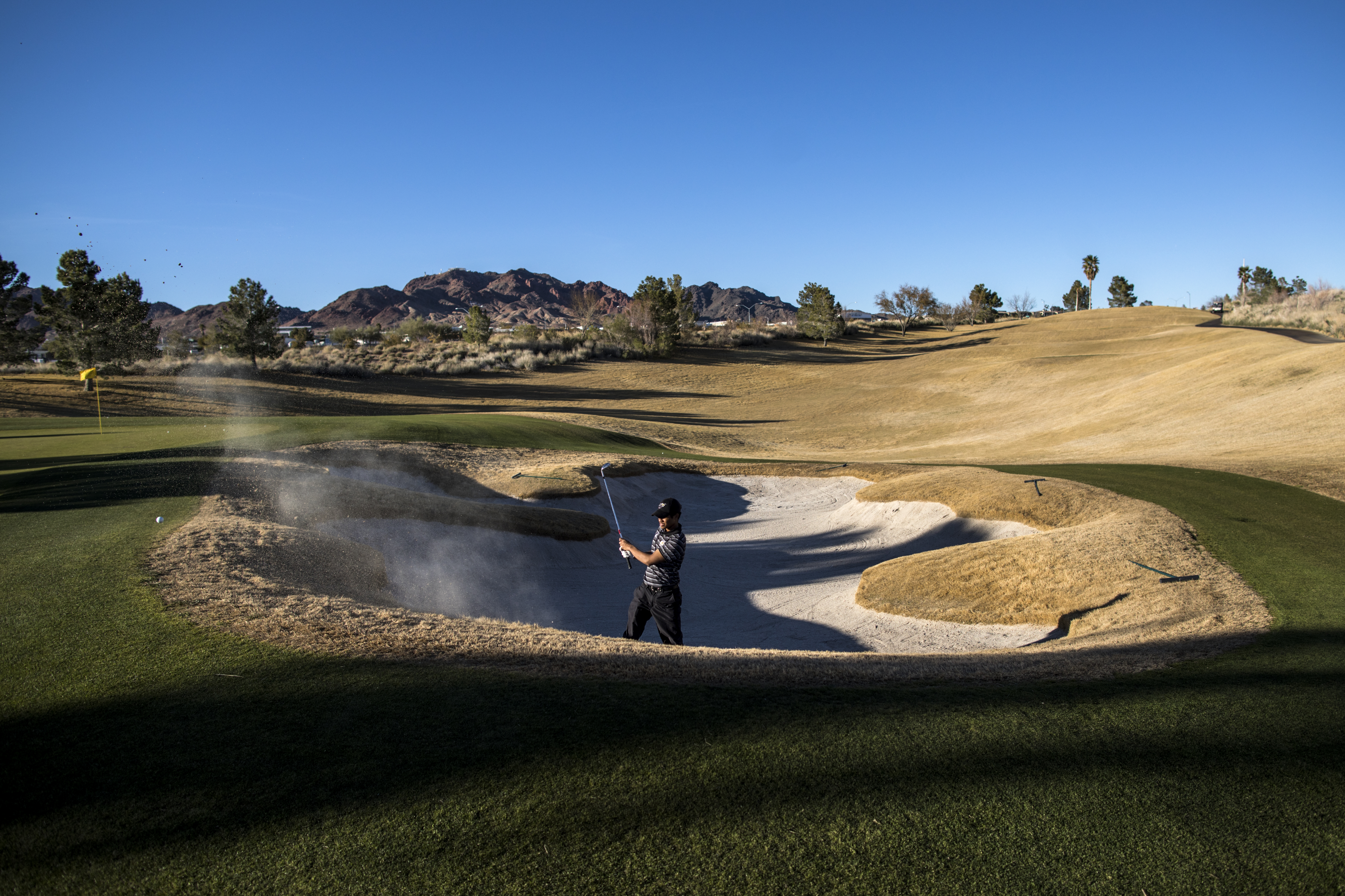 f1fa64657c8d37 Alabama State junior Noel Sims takes a practice round at the Boulder Creek  Golf Club before tournament play in Boulder City, Nev., March 8, 2018.