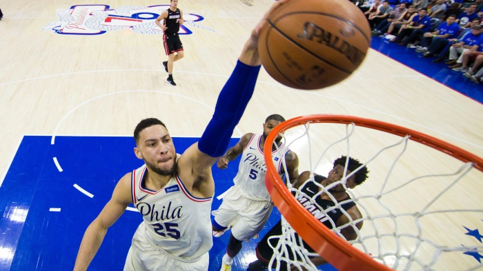reputable site 87d40 233fb Philadelphia s Ben Simmons dunks the ball during the first half of Game 1  against the Miami Heat on Saturday in Philadelphia. The 76ers won 130-103.