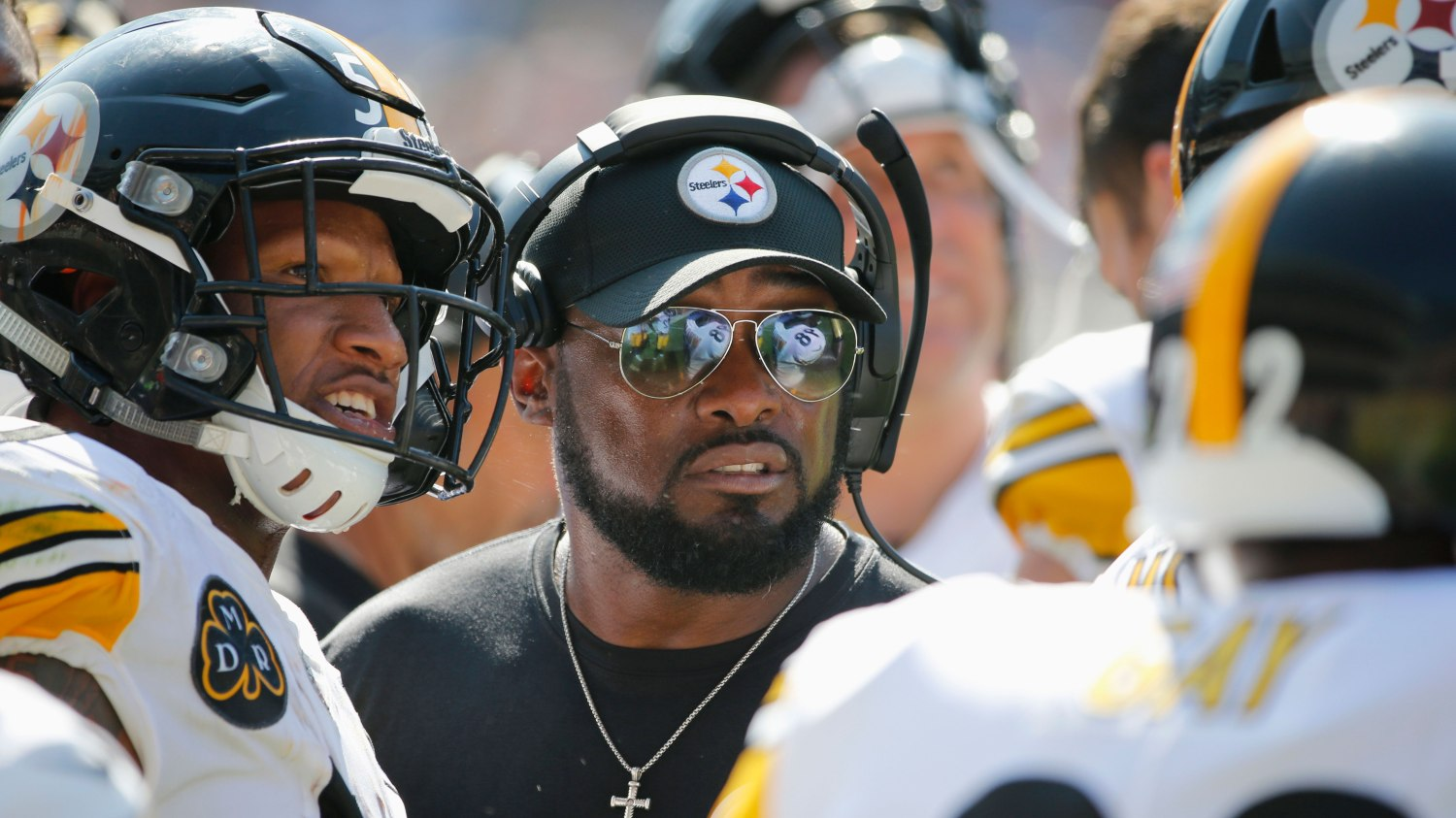 6ab44add9dc Mike Tomlin is the face of the Pittsburgh Steelers — and also of  African-American coaches in the NFL. AP Photo/Charles Rex Arbogast