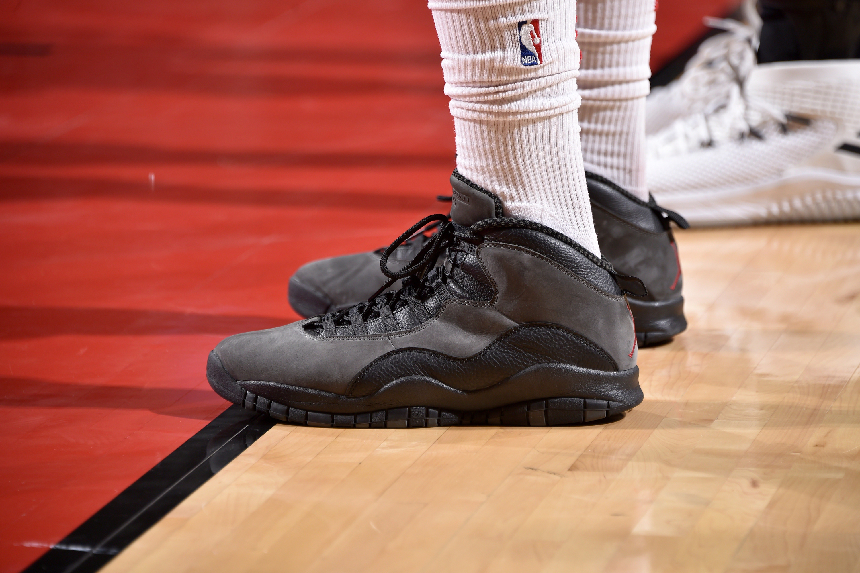 0d458a3dc2e0 The sneakers of P.J. Tucker of the Houston Rockets during the second half of  Game 5 against the Minnesota Timberwolves in the first round of the 2018  NBA ...