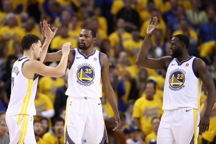 1e7649719ad89 (From left) Klay Thompson, Kevin Durant and Draymond Green of the Golden  State Warriors celebrate after a play against the Houston Rockets during  Game 6 of ...