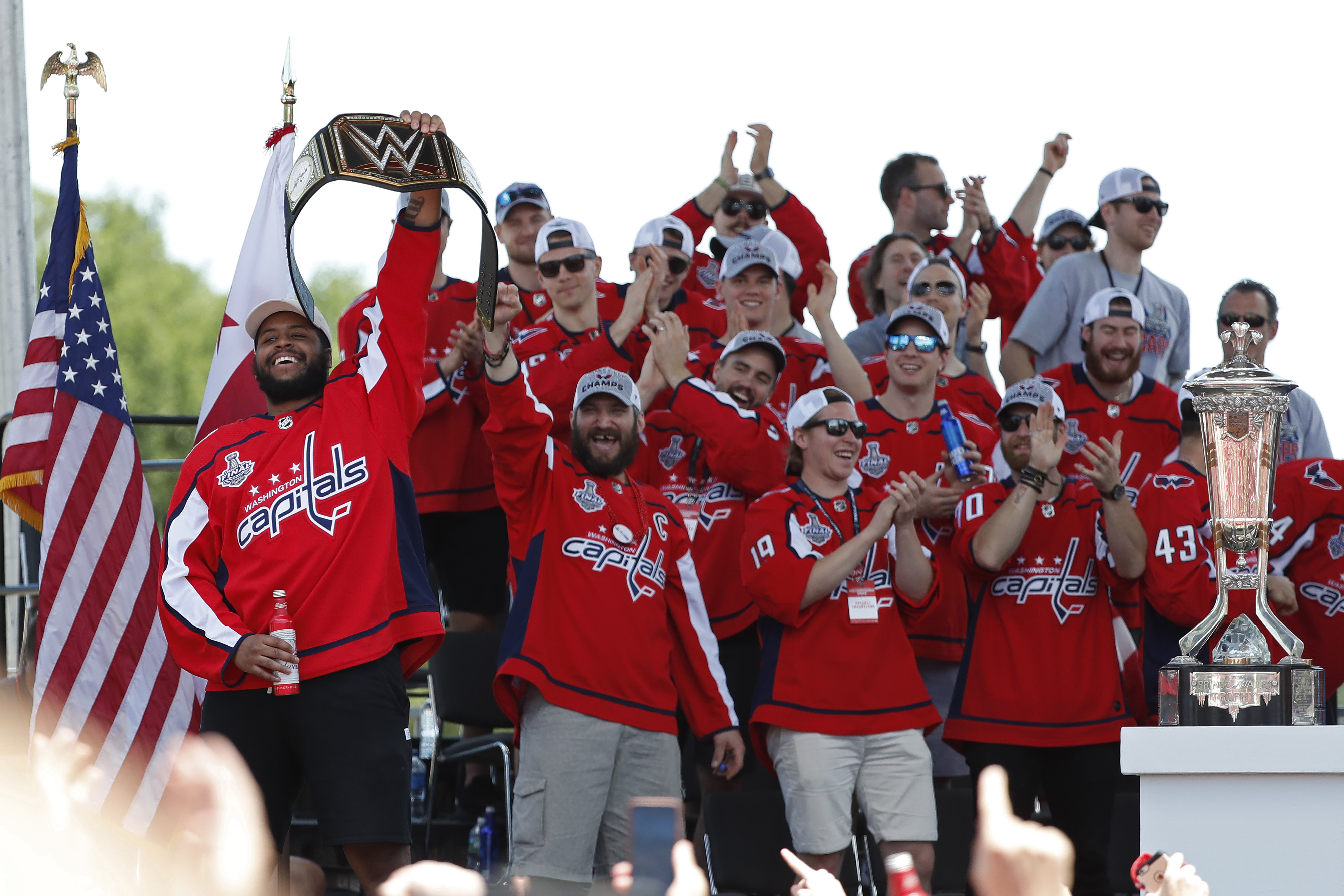 5ebad015a18 Washington Capitals right wing Devante Smith-Pelly (left) salutes the crowd  while being introduced during the Stanley Cup championship parade and ...