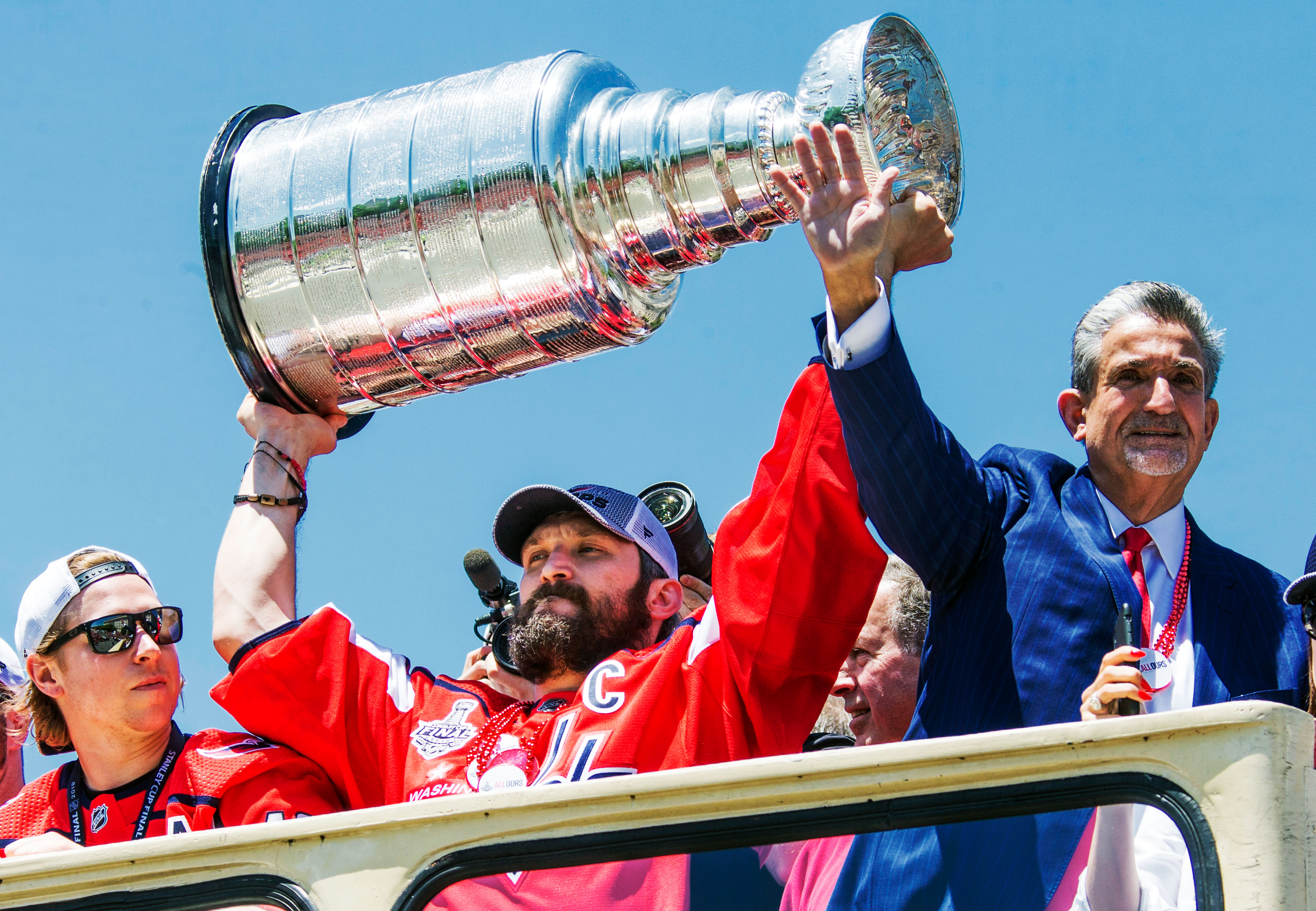 2a91ed16f82 Washington Capitals left wing Alex Ovechkin (center) holding the Stanley Cup  and owner Ted Leonsis (right) during the Washington Capitals  Stanley Cup  ...
