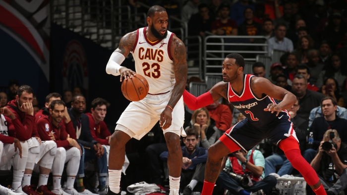 53a8fc914b7 LeBron James of the Cleveland Cavaliers handles the ball against John Wall  of the Washington Wizards on Dec. 17