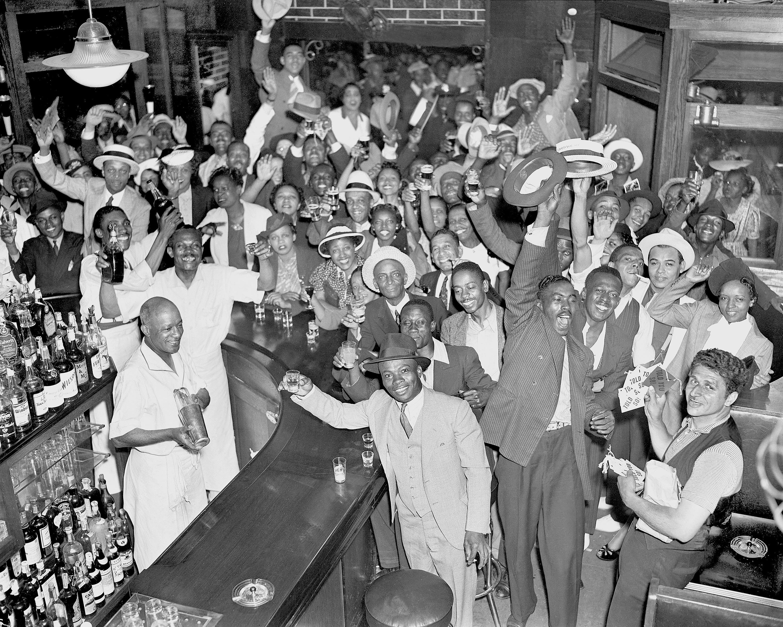 Harlem Residents At A Bar On 135Th Street Raise A