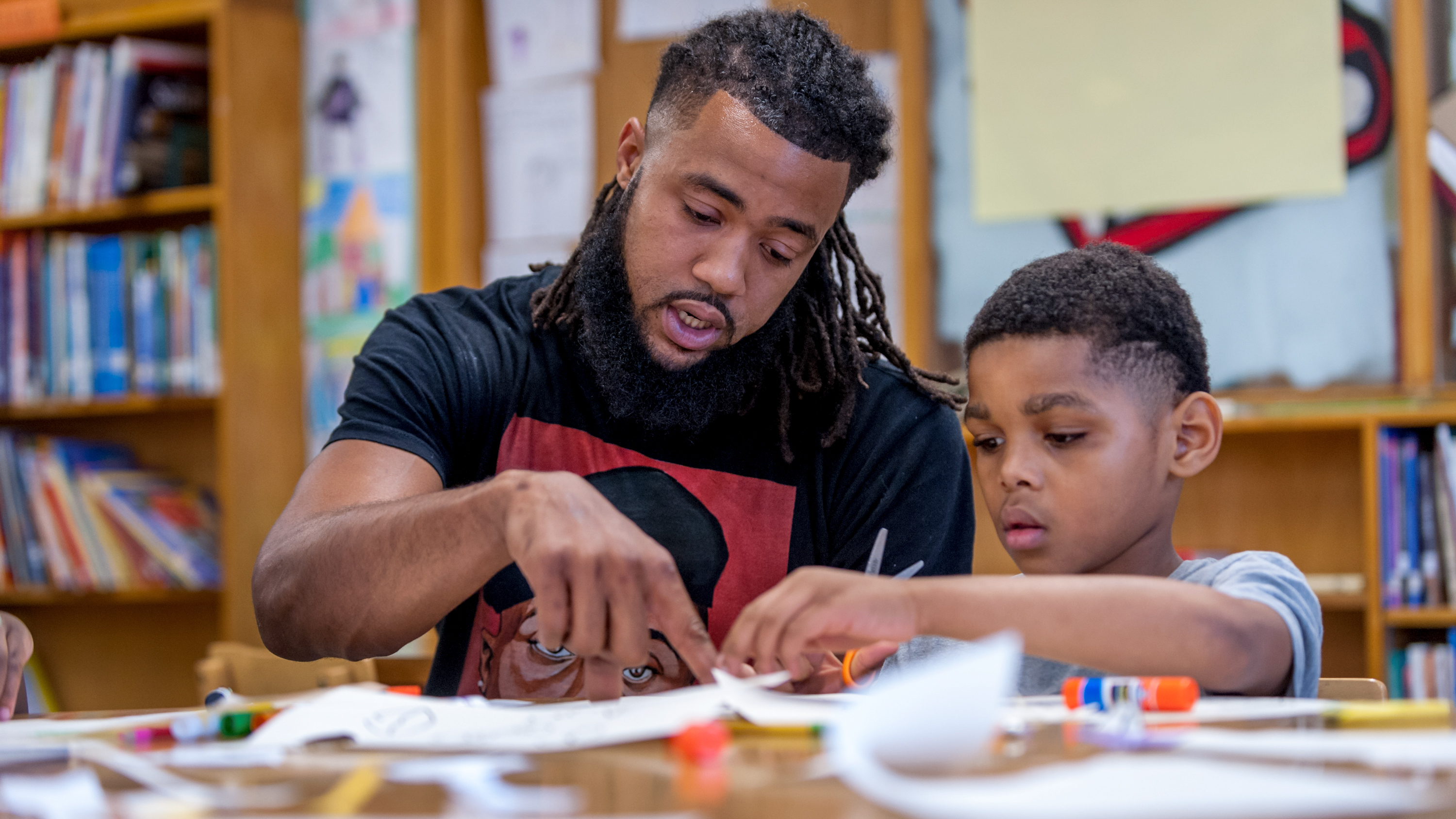 Aaron Maybin, formally an all-American linebacker at Penn State came home to inner-city Baltimore to teach art and literacy at Matthew A. Henson Elementary School.