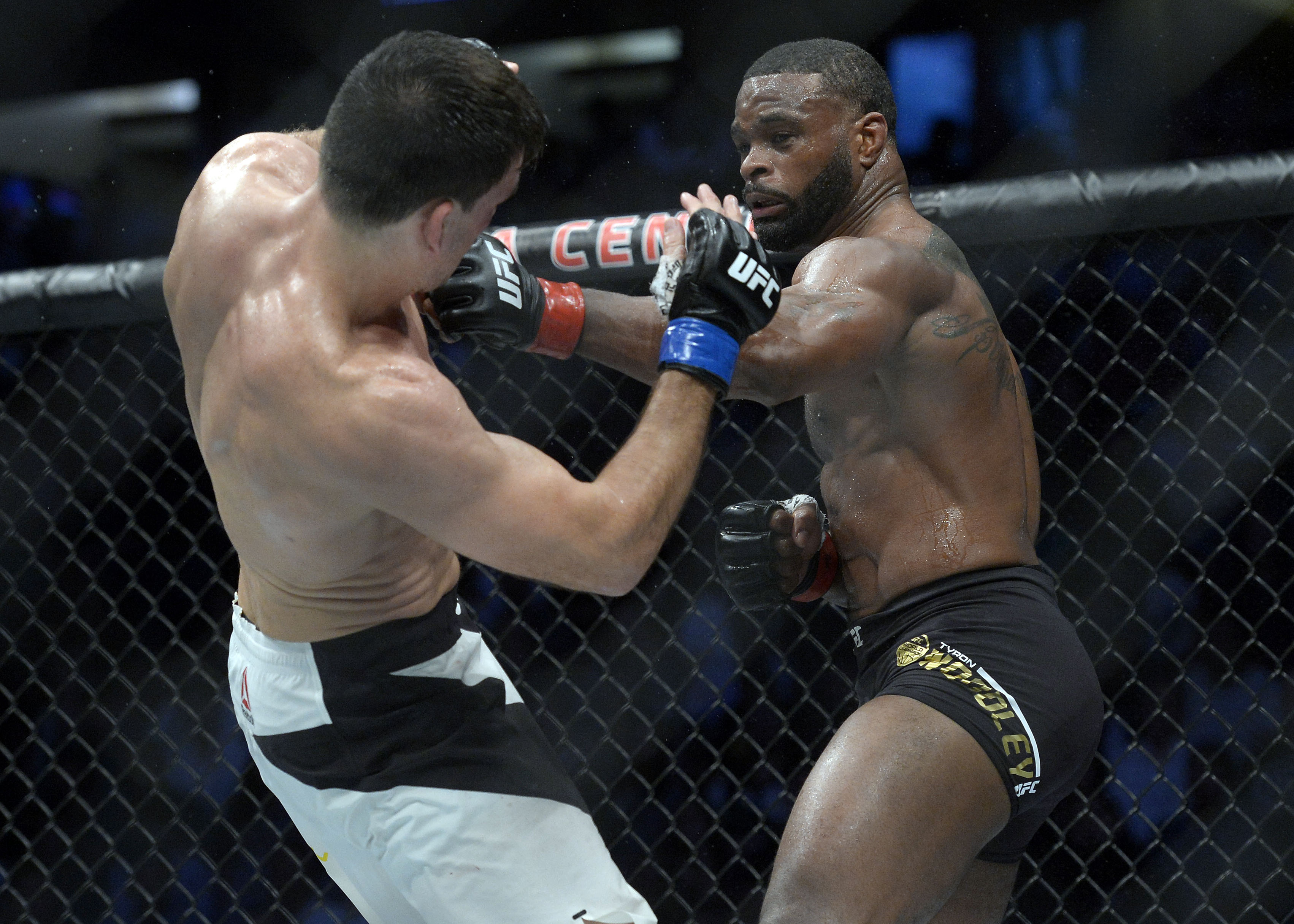 281d11e49 Tyron Woodley (right) moves in with a hit against Demian Maia (left) during  UFC 214 on July 29