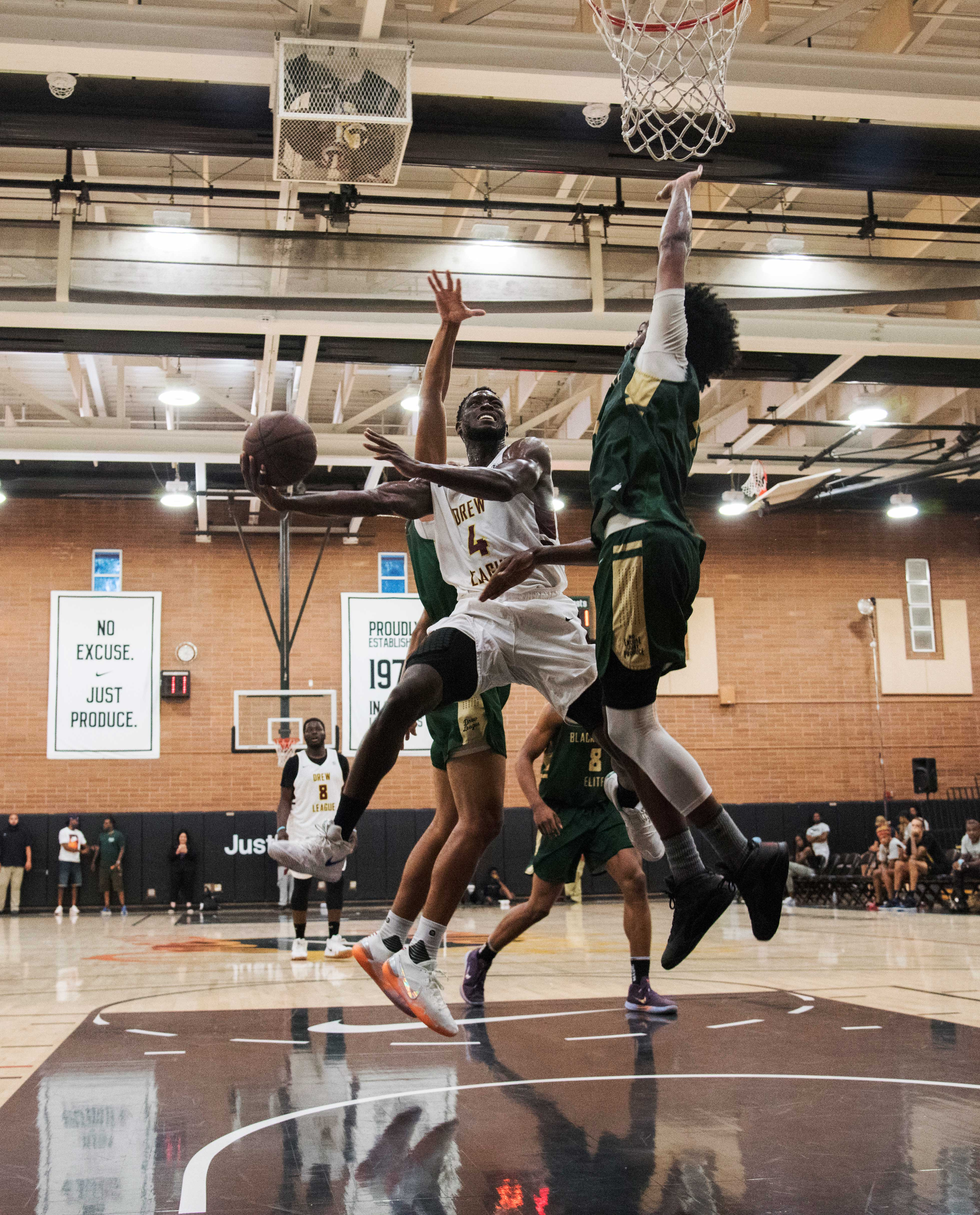 00290fa5a3a LA Loop's Mike Ojo (center) puts up two against the Black Pearls Elite  during their matchup on July 28.