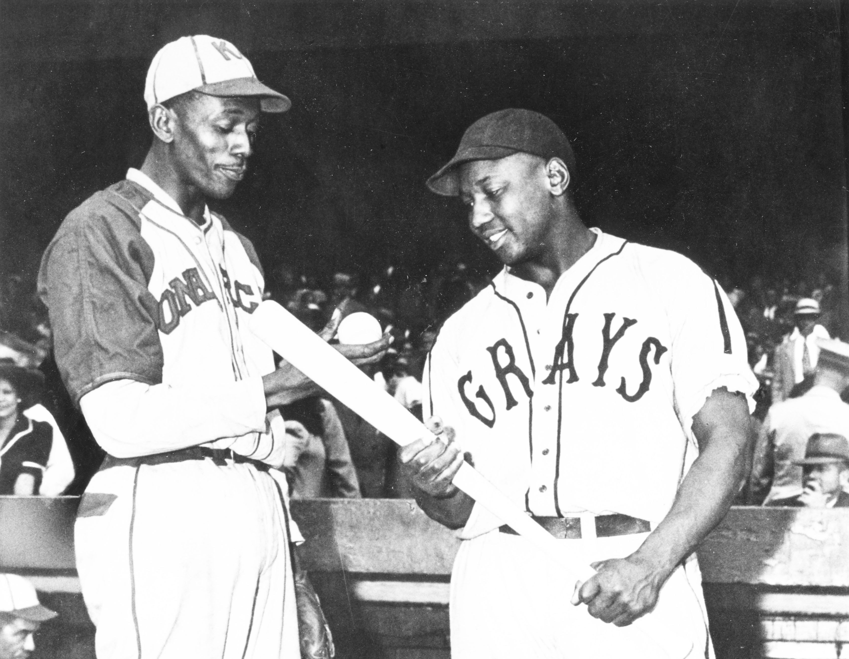 adc3db70cc8 Satchel Paige (left) of the Monarchs talks with Josh Gibson (right) of the Homestead  Grays before a game in Kansas City in 1941.