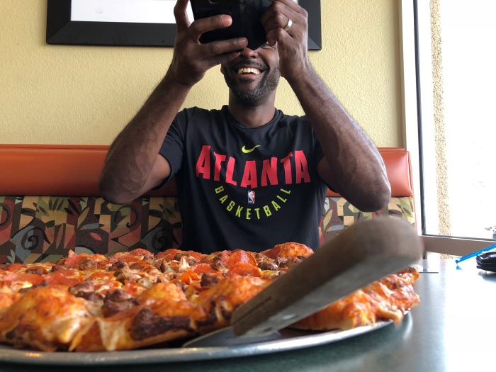 Ordering Pizza Has Its Challenges For Hawks Coach Lloyd Pierce