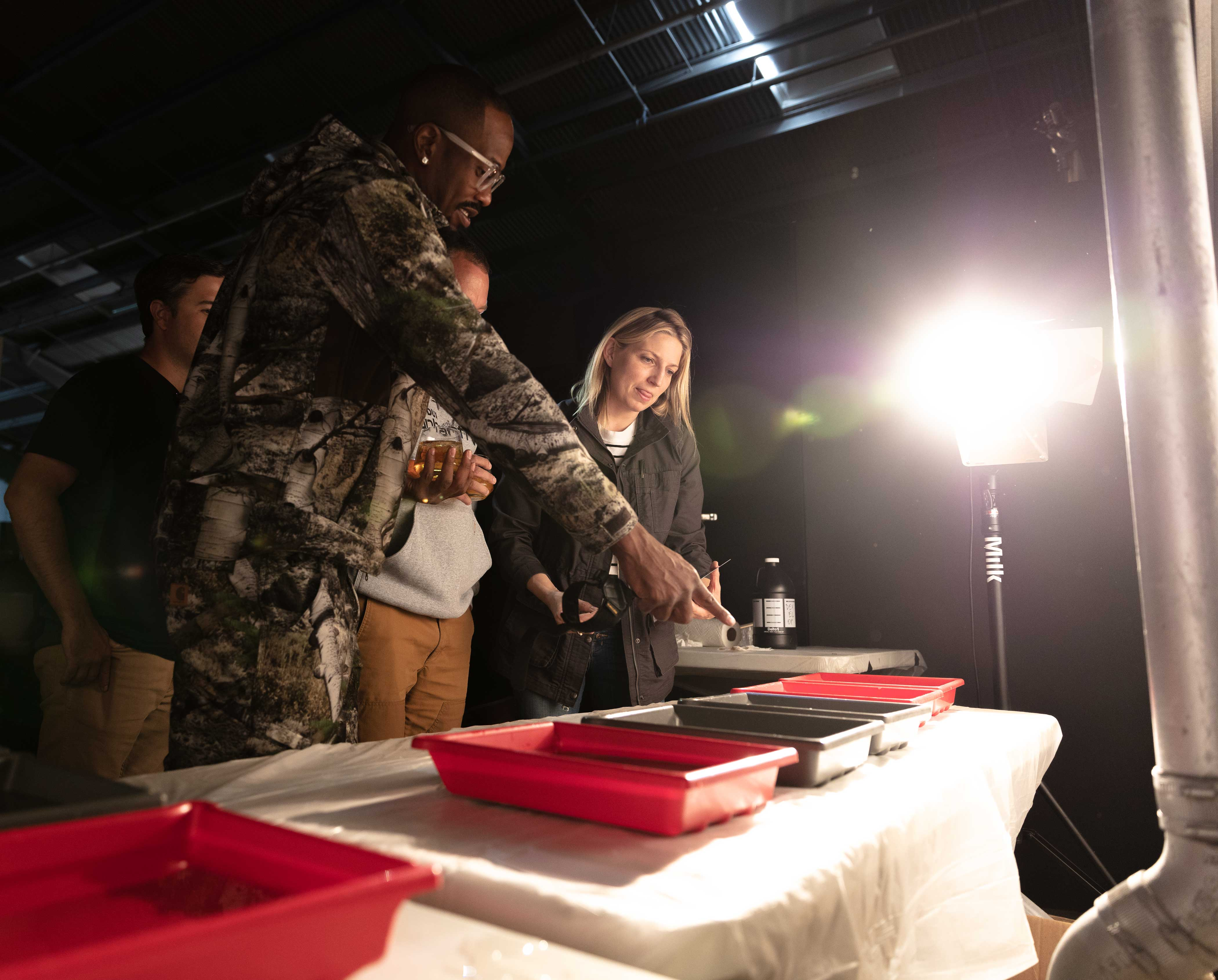6ab0041fe5265 Von Miller and celebrity photographer Victoria Will choose prints during a  recent advertising shoot for the brand Carhartt at MILK Studios.