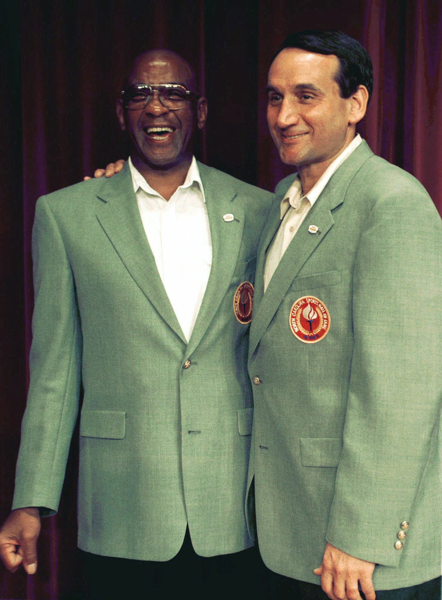 31eaeb42ce4 Duke basketball coach Mike Krzyzewski (right) embraces Henry Logan (left)