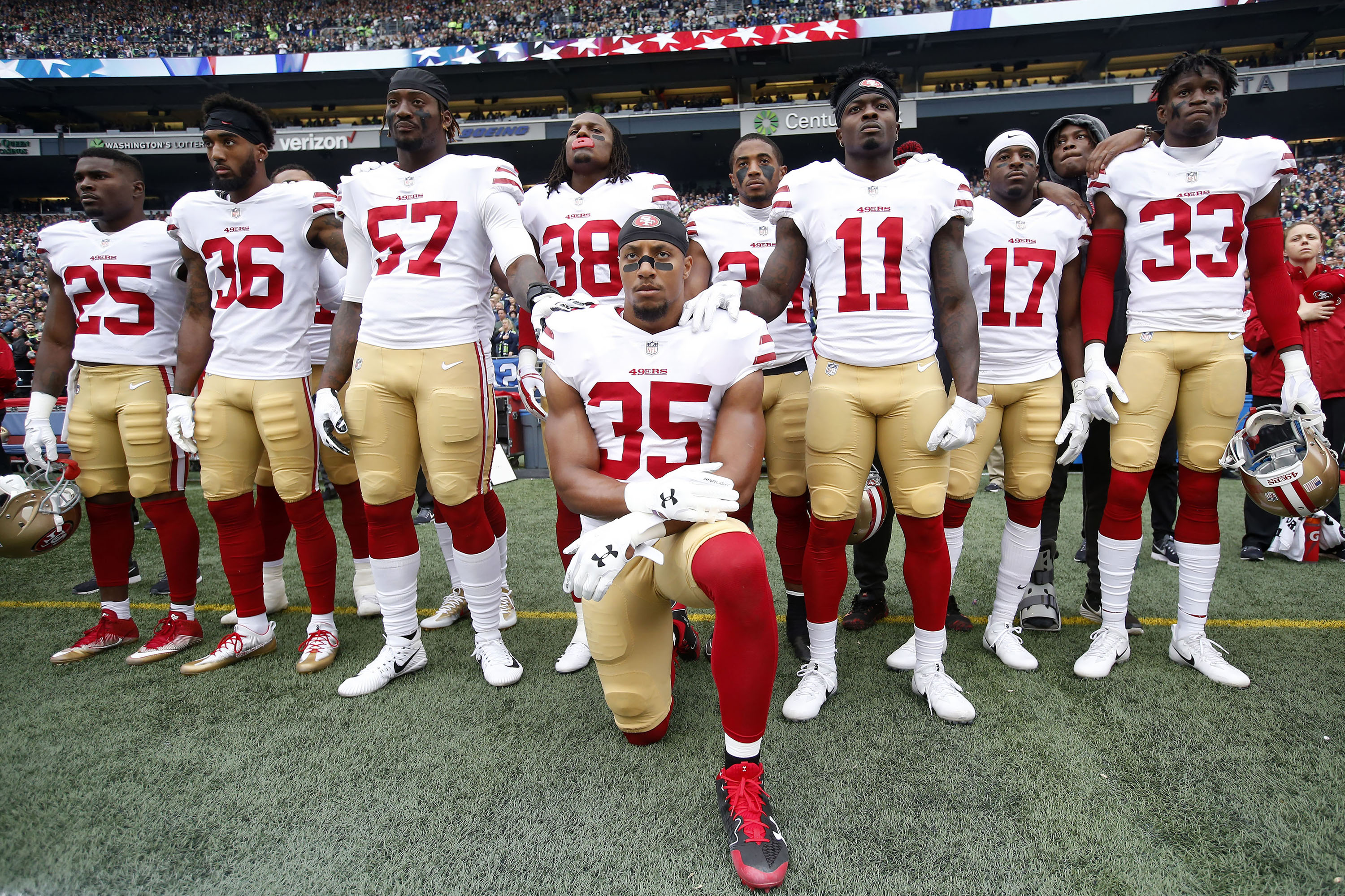 Eric Reid  35 of the San Francisco 49ers kneels during the anthem with the  support of teammates prior to the game against the Seattle Seahawks at ... 8949aa2213a1c