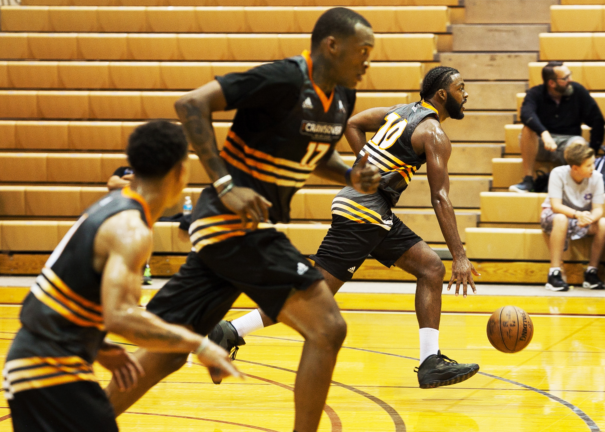 960bc356 Rakim Brown (right), of WorldwideSM, dribbles down the court during his  team's Crawsover league pro-am game against Ball is Life at Royal Brougham  Pavilion ...