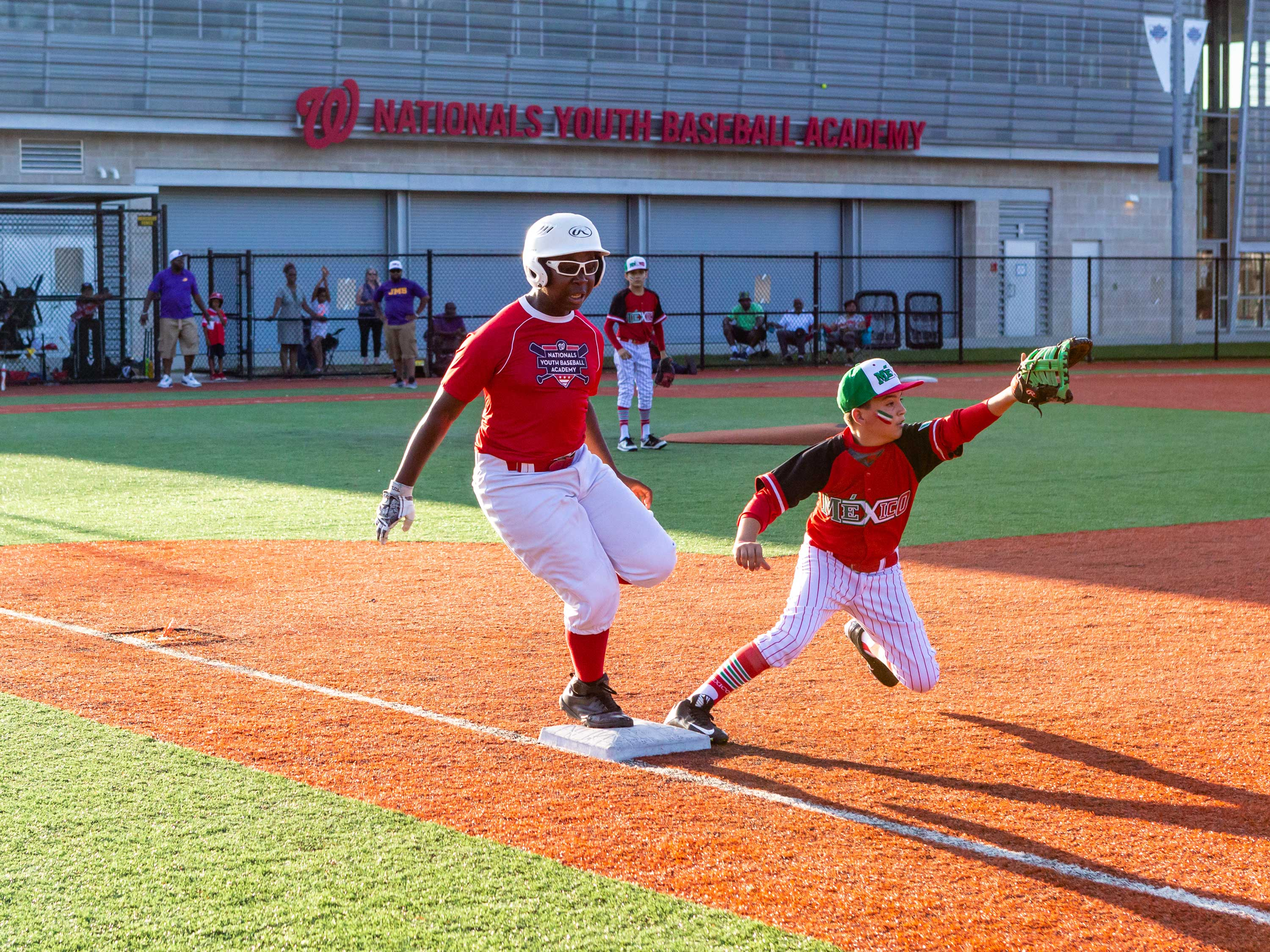 aaa51b3511a Tony Hairston of the Mamie Johnson Little League (MJLL) Majors U12 team  runs to first base during a scrimmage against a team from Mexico at the  Washington ...
