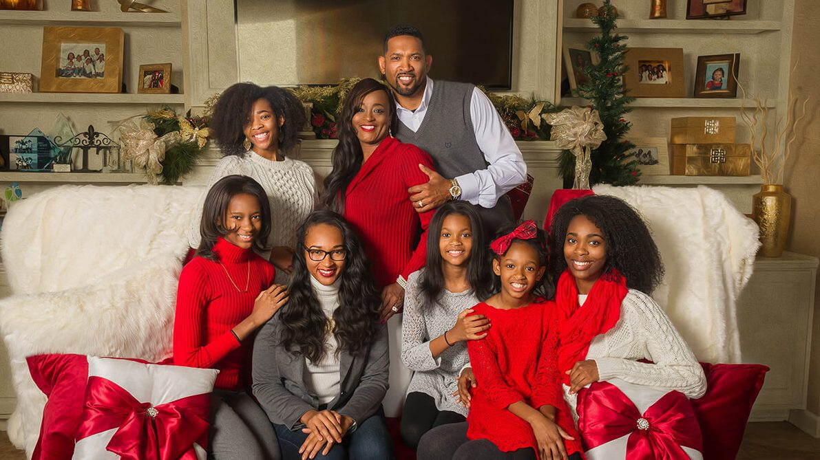Entrepreneur and motivational speaker Lenika Scott (center) developed generational wealth with her husband Gregg and their six daughters and she inspires others to become the best version of themselves.